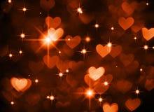 Herzhintergrund boke Foto, dunkelrote braune Farbe Abstrakter Feiertag, Feier und Valentinsgrußhintergrund Stockfotografie