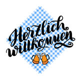 Herzlich willkommen. Welcome. Traditional German Oktoberfest bier festival . Vector hand-drawn brush lettering. Illustration on bayern pattern Stock Photo