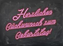 Herzlichen Glueckwunsch zum Geburtstag - Pink Neon Font on handwiped dark Chalk Board Royalty Free Stock Photo