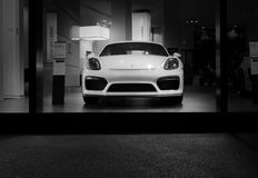 Herzliya, Israel- November, 2017: White Porsche 911 Carrera 4 car stands parked on the stage. Front view. stock images