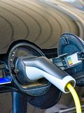 A Volkswagen Golf GTE is charged at a charging station stock images