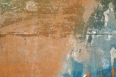 Hes, skrapad och skalad yttersida med blått och gulaktigt-bro arkivbild