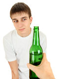Hesitant Teenager and Beer Royalty Free Stock Images