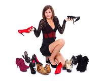 Hesitant woman with shoes. Hesitant woman with her shoes over white background Royalty Free Stock Photo