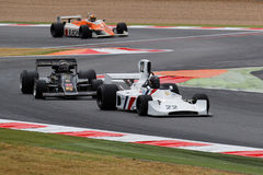 Hesketh, Lotus and Arrows on the track Stock Photos