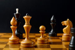 Сhess on a black background. Сhess board and pieces on a black background Stock Images
