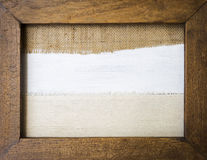 Hessian and canvas fabric texture background. Hessian and canvas fabric texture in vintage wooden picture frame Stock Image
