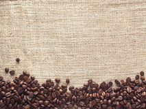 Hessian and coffee beans - Stock Image Stock Photography