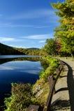 Hessian Lake and Foliage near Bear Mountain, NY. Hessian Lake found at the base of Bear Mountain in Rockland County, New York. Seen here is the beautiful blue Royalty Free Stock Photos