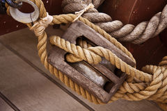 Hessian rope and wooden pulley Royalty Free Stock Photos