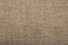 Hessian sackcloth burlap woven texture background / cotton woven fabric background with flecks of varying colors of beige and brow. N. with copy space. office royalty free stock image