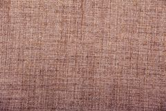 Hessian sackcloth burlap woven texture background / cotton woven fabric background with flecks of varying colors of beige and brow. N. with copy space. office stock image