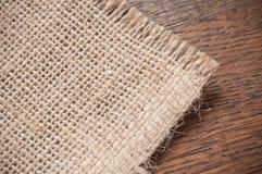 Hessian texture on wooden background. Closeup of hessian texture on wooden background royalty free stock photos