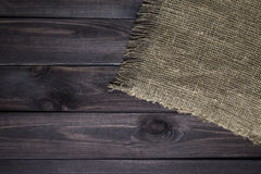 Hessian texture on wooden table. Background. Wooden table with sacking stock photos