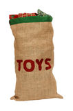 Hessian toy sack stuffed full with Christmas presents Stock Photos
