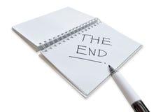"""Het """"EIND"""" dat op notitieboekje wordt geschreven Royalty-vrije Stock Foto's"""