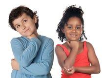 Het aanbiddelijke kinderen denken stock fotografie