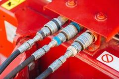 Het aangesloten systeem van bouw, landbouw of andere machines van hydraulische drukpijpen stock afbeeldingen