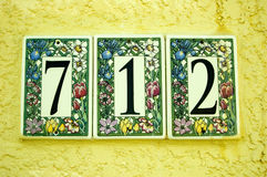 Het aantal van de deur betegelt 712 Stock Afbeelding