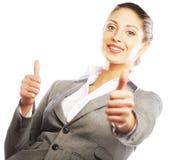 Het aantrekkelijke bedrijfsvrouw geven beduimelt omhoog stock afbeelding