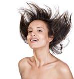 Het aantrekkelijke jonge vrouw glimlachen royalty-vrije stock fotografie