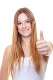 Het aantrekkelijke jonge vrouw tonen beduimelt omhoog Stock Afbeelding