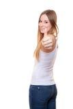 Het aantrekkelijke jonge vrouw tonen beduimelt omhoog Royalty-vrije Stock Fotografie