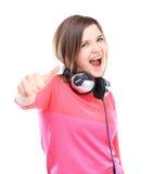 Het aantrekkelijke jonge vrouw tonen duimen omhoog stock afbeelding