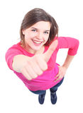 Het aantrekkelijke jonge vrouw tonen duimen omhoog stock afbeeldingen
