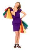 Het aantrekkelijke jonge vrouw winkelen Royalty-vrije Stock Afbeeldingen