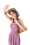 Het aantrekkelijke meisje golven die bij de zomer glimlacht Stock Foto's
