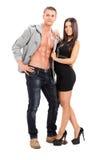 Het aantrekkelijke paar stellen op witte achtergrond Royalty-vrije Stock Afbeelding