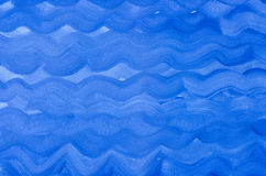 Het abstracte blauwe geschilderde patroon van waterverfgolven Royalty-vrije Stock Foto's