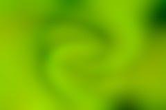 Het abstracte groene spiraalvormige behang van het rimpelingsonduidelijke beeld Royalty-vrije Stock Foto