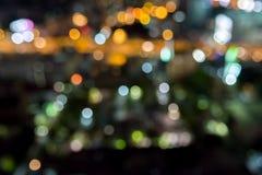 Het abstracte licht van de de stadsnacht van onduidelijk beelddefocus Royalty-vrije Stock Fotografie