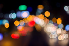 Het abstracte licht van de de stadsnacht van onduidelijk beelddefocus Royalty-vrije Stock Foto's