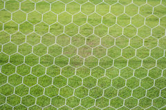 Het abstracte netto patroon van het voetbaldoel met groen gras royalty-vrije stock fotografie