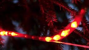 Het abstracte rood die defocused de lichten van de Kerstmiskleur knipperen stock video
