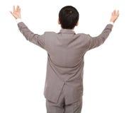 Het achter zijn van zakenmanblikken opgeheven handen naar omhoog Stock Fotografie