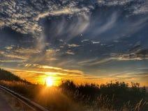 Het achtervolgen van Sunsets Stock Foto