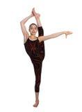 Het acrobatische gymnastiek- meisje uitoefenen Royalty-vrije Stock Afbeeldingen