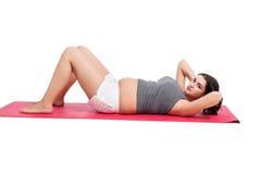 Het actieve zwangere vrouw uitwerken Royalty-vrije Stock Fotografie