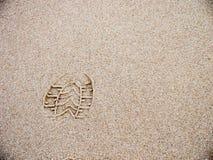 Het af:drukken van de schoen in het zand Stock Foto