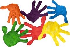 Het af:drukken van de verf van kindhanden stock afbeeldingen