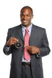 Het Afrikaanse Amerikaanse Kompas van de Holding van de Zakenman Stock Afbeeldingen