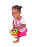 Het Afrikaanse Aziatische ei van de de chocoladeester van de meisjesholding Royalty-vrije Stock Foto's