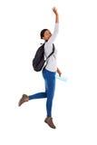 Het Afrikaanse universitaire student springen royalty-vrije stock afbeeldingen