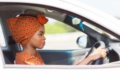 Het Afrikaanse vrouw drijven stock foto