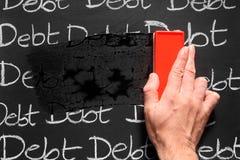 Het afvegen schulden weg. Royalty-vrije Stock Foto