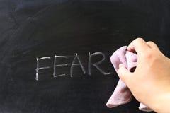 Het afvegen van vrees stock afbeeldingen